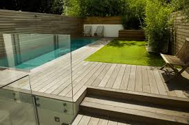 lane swimming pool and contemporary garden designed built by small
