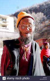 Family Safety A Tibetan Old Man In The Lamasery Praying Family Safety And Good