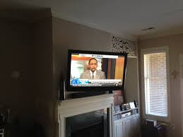 full motion tv wall mount installation over apartment fireplace