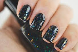 black nail polish with iridescent glitter and shimmer extract