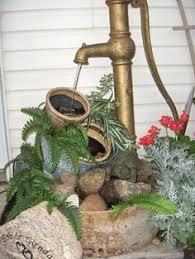 small garden pond with old hand pump garden junk forum