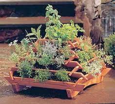 a simple idea for a small footprint herb garden called a pyramid