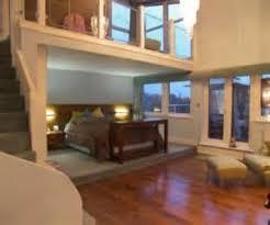 split level bedroom photo of split level beige brown bedroom master bedroom mezzanine