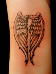 angel wings secret ink tattoo