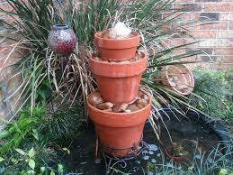 Small Water Gardens In Containers 11 Amazing Water Fountains Made From Planters Garden Lovers Club