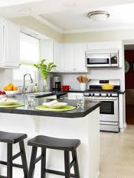 Kitchens That Maximize Small Footprints Glass Front Cabinets - Small kitchen white cabinets
