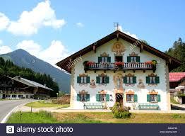 traditional bavarian farm house with painted facade jachenau
