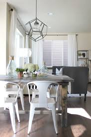 farmhouse table with metal chairs statement light fixture home living spaces pinterest dining