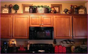creative ideas for decorating above kitchen cabinets creative