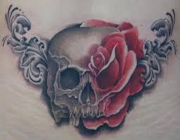 art junkies tattoo studio tattoos skull skull and rose tattoo