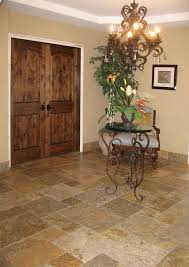 attractive stone tile for entryway with round glass entry table of