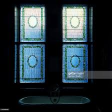 stained glass window above bathroom sink stock photo getty images