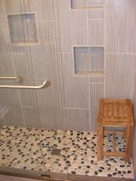 abundant grey glass tile with stone accent wall tiled as well as