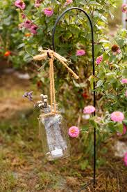 homegrown flowers in mason jars fall rustic backyard wedding