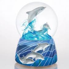 dolphin musical snow globe bring home one of the most intelligent