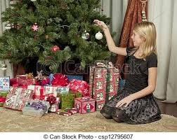 up christmas decorations hanging up christmas decorations girl sitting in stock