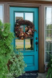 blue color of entrance home with small garden and brown color of