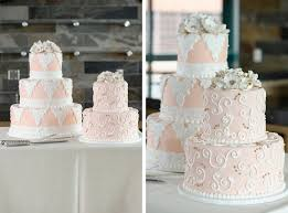 flowers and lace wedding cake from once in a blue moon bakery in cary