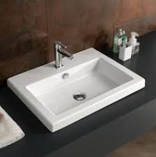 ceramic bathroom sinks pros and cons porcelanosa krion solid surface wall mounted sink basins http