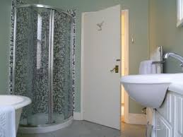 enjoyable corner curved walk in shower with pedestal sink as well