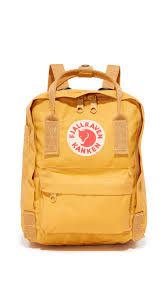 warm yellow shop fjallraven kanken mini backpack in ochre frost green graphite