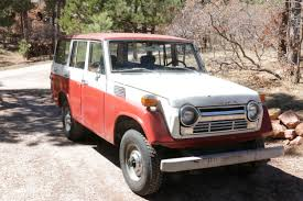 original land cruiser sold 1977 toyota land cruiser fj55 all original red line land