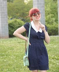 cameoko jewelry blue polka dot dress and a mint green bag