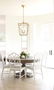 dining space with gold lantern light fixture ballard designs dining space with gold lantern light fixture ballard designs bamboo chairs