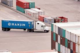 logistics in the news truck with a hanjin container at port