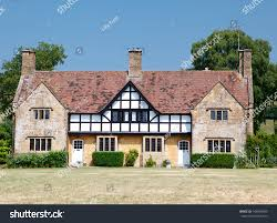 English Tudor Style by Traditional Medieval English Mansion Built Tudor Stock Photo