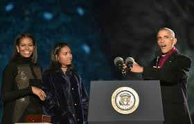 the obamas light their last tree as the family