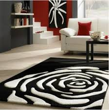 tappeti moderni bianchi e neri soggiorno nero e beige mattsole