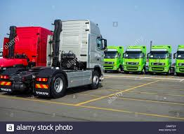 the volvo commercial trucks from the volvo trucks assembly plant waiting to be loaded