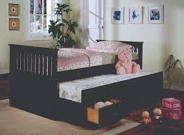 Bedroom Oak Wood Trundle Beds With Decorative Bedding And Dresser
