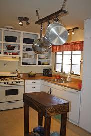 alder wood alpine lasalle door kitchen island with pot rack