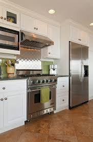 stainless steel backsplash kitchen kitchen eclectic with tiled