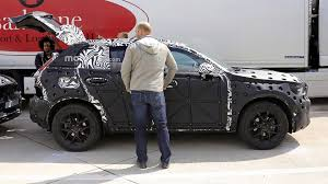 volvo xc40 spied covered in swiss cheese like camo 35 photos