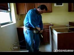 How To Install Base Cabinets With Shims How To Install Base Cabinets Part 3 Of 4 Wmv Youtube