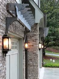 simple pergola over garage door i have thought about doing this