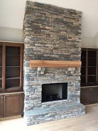 affordable granite stone fireplaces between unfinished wood