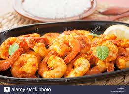 sizzle platter tandoori prawns on a cast iron sizzle platter served with basmati