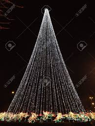 lights in triangle shape of tree stock photo