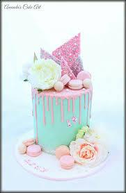 pastel drip cake with rainbow choc shard macarons silk flowers