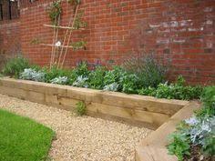 raised beds along a fence make a great border garden pinterest