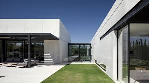concrete and glass surfaces extend from inside to outside of