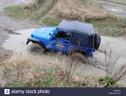 modified jeep wrangler modified jeep wrangler driving off road in deep wet mud and water