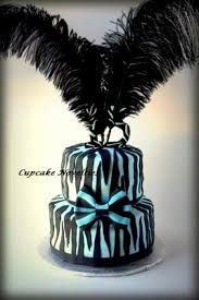 black and blue zebra stripe birthday cake with a striped bow and