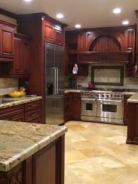 kitchen colors with cherry cabinets cherry kitchen cabinets with gray wall and quartz countertops