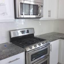 Range Hood Backsplash by Backsplashes Elegant White Cabinets With Stainless Steel Gas