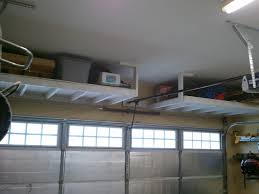 Room Over Garage Design Ideas Above Garage Door Lumber Storage Above Garage Door Storage Plan